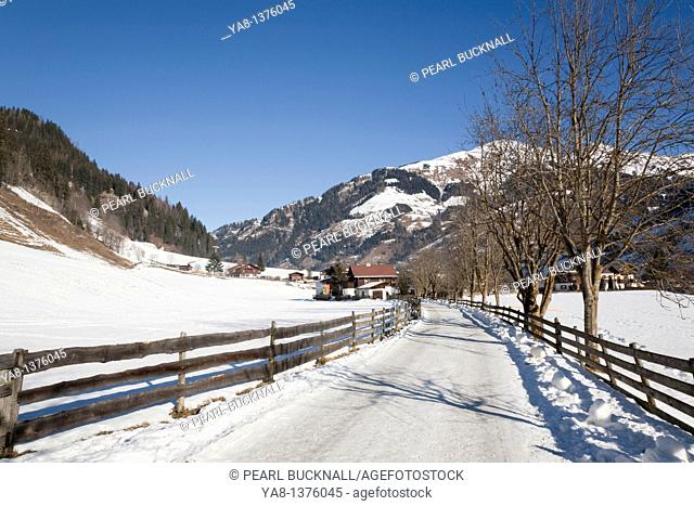 Rauris Rauriser Sonnen Valley Austria Europe / January Winterwanderweg cleared walking trail in Alpine ski resort with snow in winter