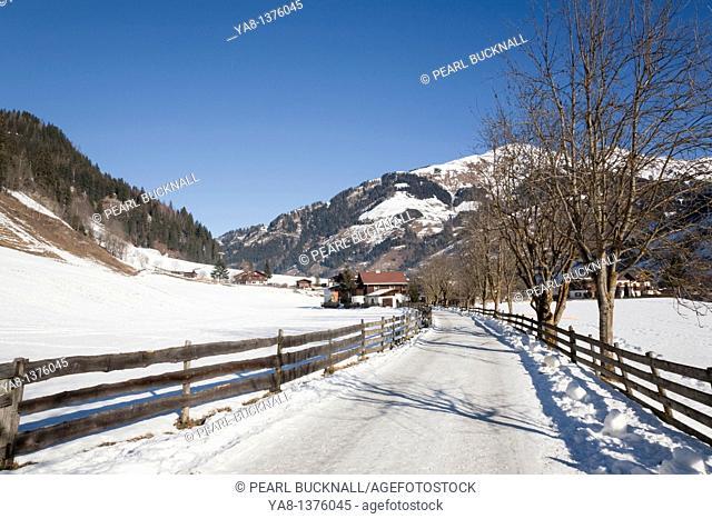Rauris Rauriser Sonnen Valley Austria Europe / January Winterwanderweg cleared walking trail in Alpine ski resort with snow in winter