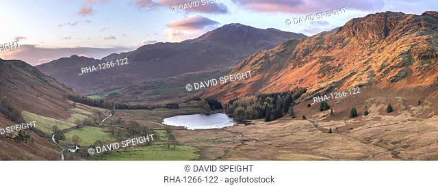 Stitched panoramic image showing sunrise at Blea Tarn in autumn, Lake District National Park, UNESCO World Heritage Site, Cumbria, England, United Kingdom