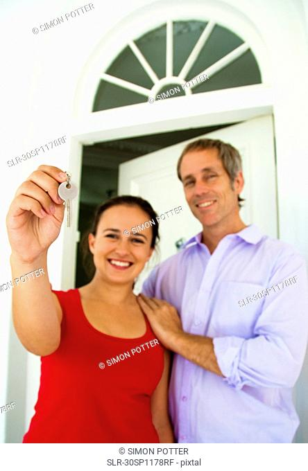 Couple hold up house key