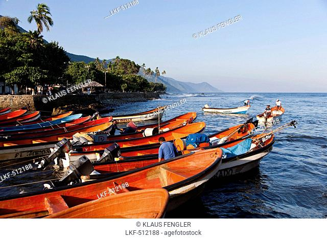 Fishermen with boats, Puerto Columbia, Henri Pittier National Park, Venezuela