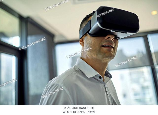 Man wearing VR glasses in office