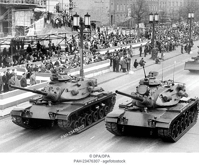 French tanks driving past a VIP stand during a parade on occasion of the 'Armed Forces Day' on 25th April 1964 in Berlin. - Berlin/Berlin/Germany