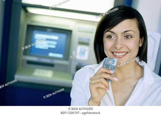 Woman at the cash point