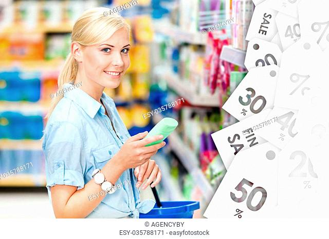 Girl at the shop choosing cosmetics, offer of the day. Concept of consumerism, retail and purchase