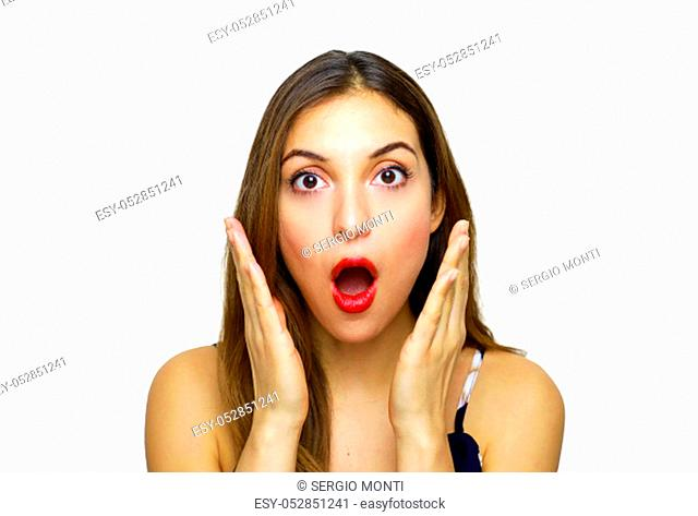 Surprised woman shouts and holds cheeks by hand. Beautiful shocked girl looking at camera. Facial expressions
