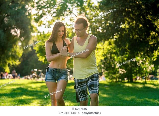 Man and woman dancing Latin American in park in summer