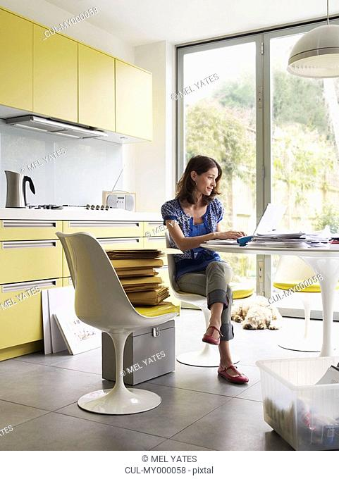 Woman running business at kitchen table