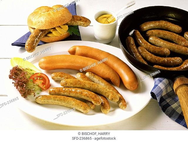 Fried sausages & Vienna sausages on plate, roll with sausage