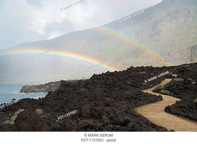 Scenic view of double rainbow over mountains and sea, Frontera, Island El Hierro, Spain