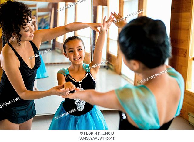 Mature woman teaching ballerinas