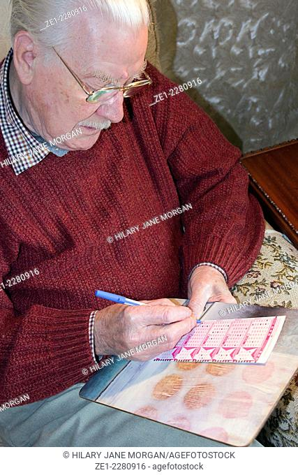 Old man playing the Euromillions lottery