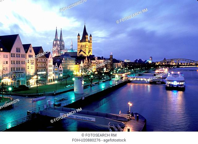 Germany, Cologne, Koln, Nordrhein-Westfalen, Rhine River, Europe, Scenic view at night of the city of Cologne (Koln) and the Cologne Cathedral (Dom) along the...