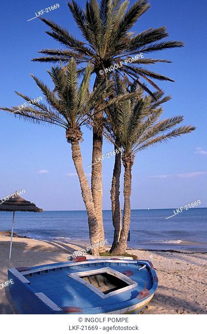 Palm beach and boat, Plage Seguia, Djerba Island, Tunisia, North Africa, Africa