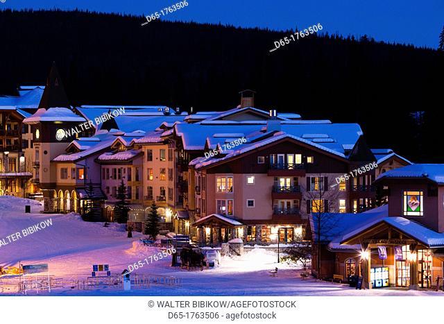 Canada, British Columbia, Sun Peaks, Sun Peaks Resort, elevated town view, winter, dusk