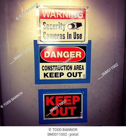 Danger keep out warning signs at construction area entrance