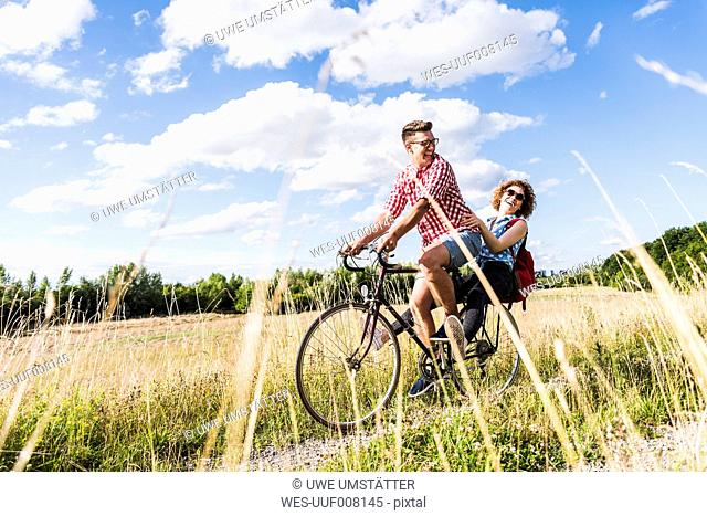 Happy young couple on a bicycle tour