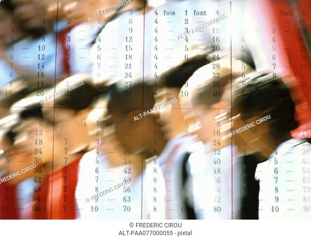 School children, close-up, superimposed with multiplication table
