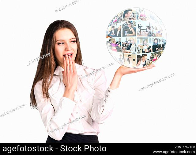 Surprised young woman present a collage sphere on the open hand palm, over white background