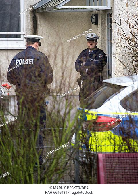 Police standing before a residence in Duesseldorf, Germany, 25 March 2016. .Here the Islamist Samir E. was arrested the day before