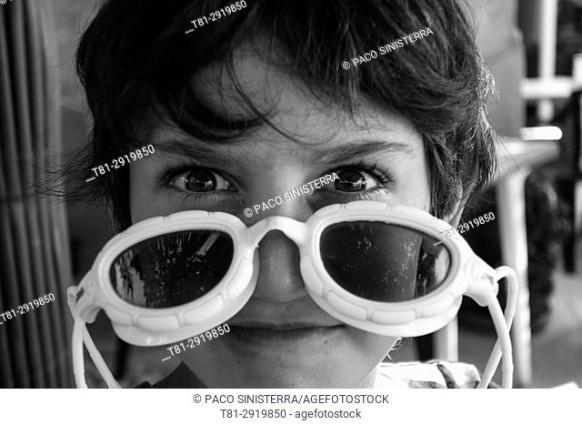 Boy with diving goggles, Barcelona, Spain
