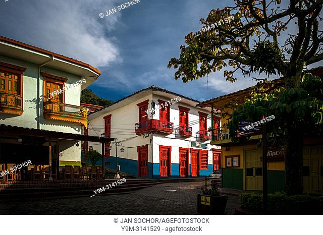 Brightly painted colonial houses are seen on the main plaza during the sunrise in Jericó, a village in the coffee region (Zona cafetera) of Colombia
