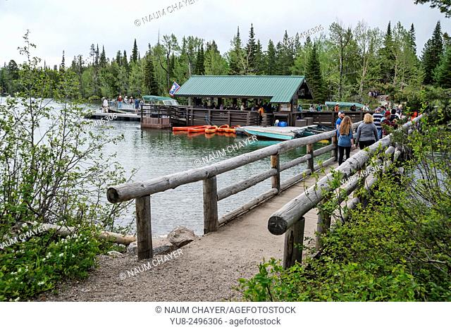 Pier for excursion boats and wooden footbridge, Grand Teton National Park, northwestern Wyoming, USA