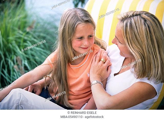 Young Mother with blond small daughter