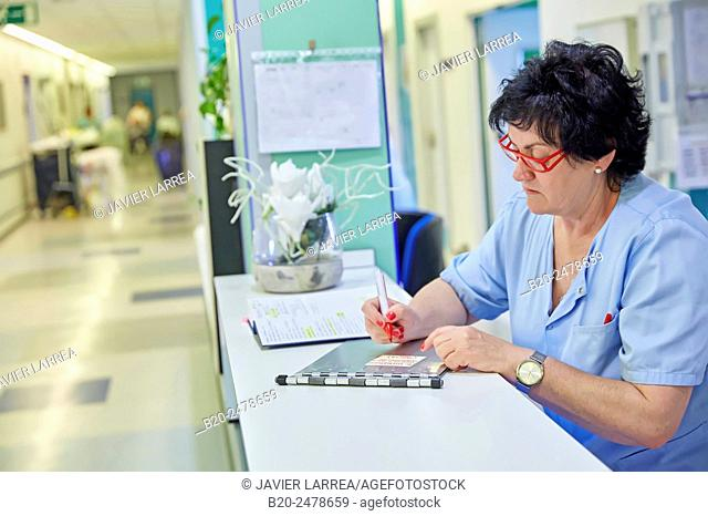 Nurse doing paperwork, Hospital Donostia, San Sebastian, Basque Country, Spain
