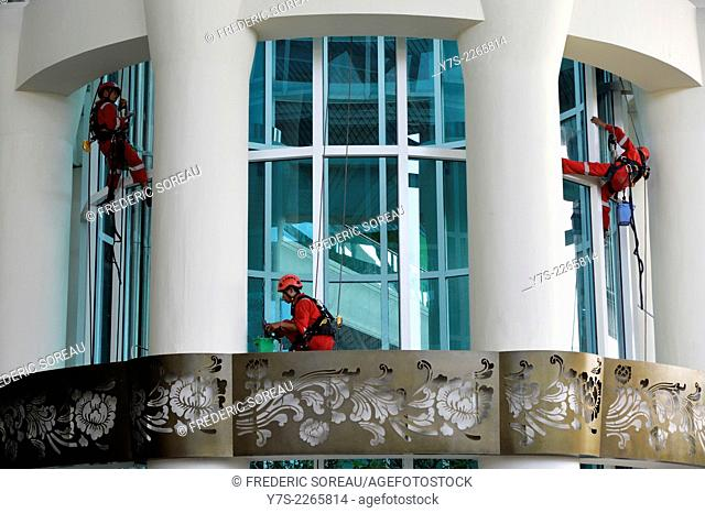 Window cleaners at Ngurah Rai International Airport, Denpasar, Bali, Indonesia, South East Asia