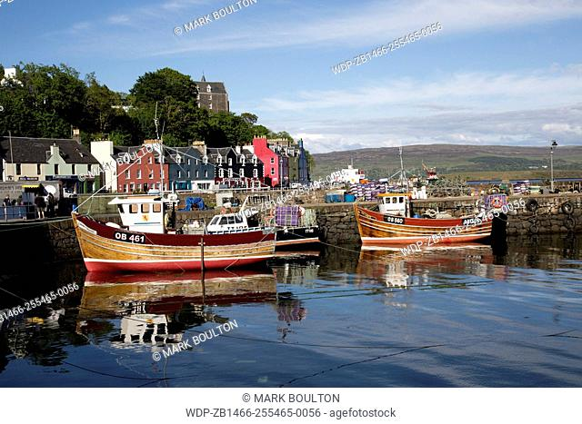 Small fishing boats moored Tobermory harbour Isle of Mull Scotland