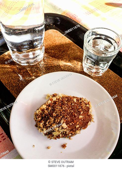 Traditional Greek Christmas Bisquit Melomakarona and glass of Raki, Tsikoudia