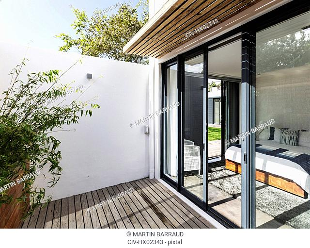 Sunny, modern home showcase patio and bedroom