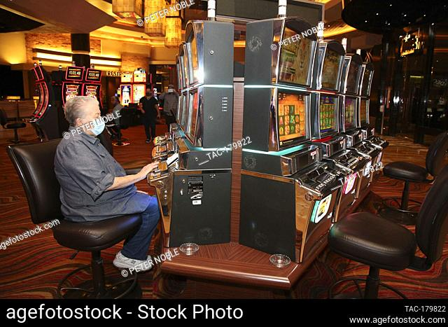 Las Vegas, NV - June 4, 2020: Local Niemi Phyllis Plays the slots during the Grand Re-Opening of Red Rock Casino Resort & Spa at 12:01 AM on June 4
