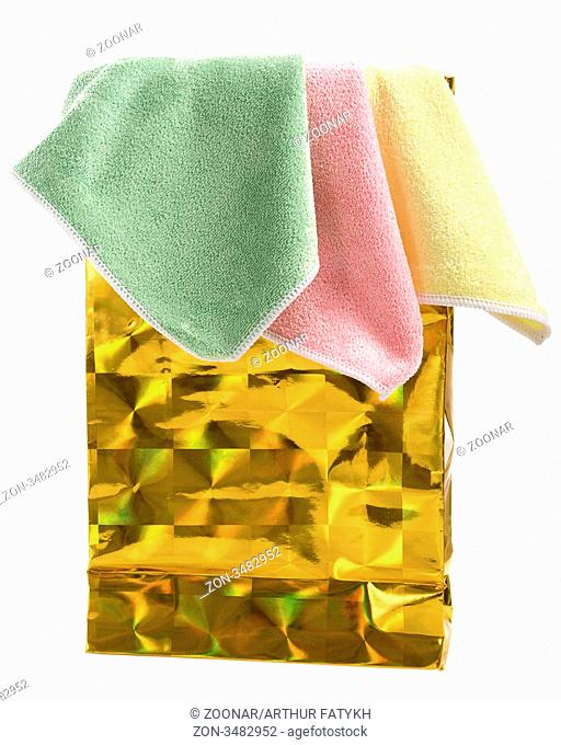 Gold paper-bag and towels. Isolated on white background
