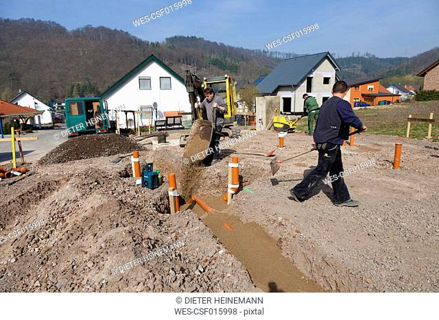 Germany, Rhineland-Palatinate, house building, earth works, laying pipes