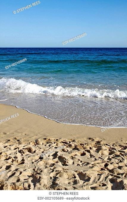 Waves reaching Porthcurno beach in Cornwall UK