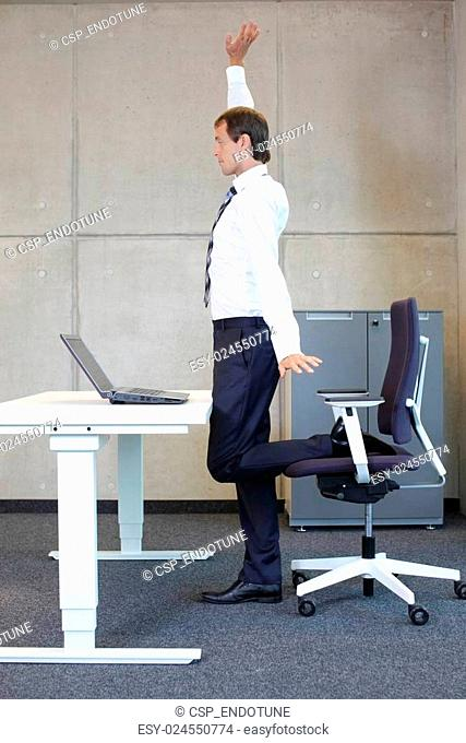 man exercises in office