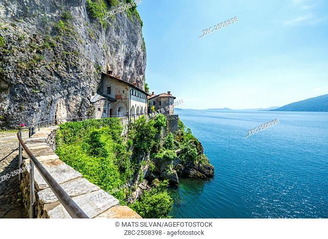 Eremo di Santa Caterina del Sasso and lake Maggiore with mountain in a sunny day in Lombardy, Italy