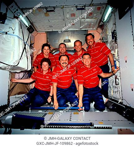 The seven crew members for STS-101 pose for an inflight crew portrait on the International Space Station. Pictured in Unity or Node 1 are (rear