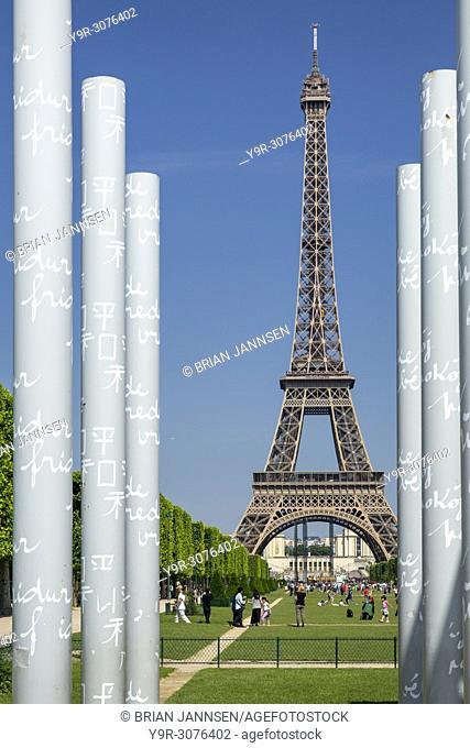 View along Champ de Mars of the Eiffel Tower through the columns of the Peace Memorial, Paris, France
