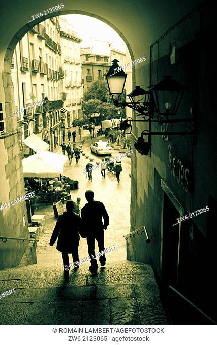 Passing couple at Plaza Mayor, Madrid, Spain