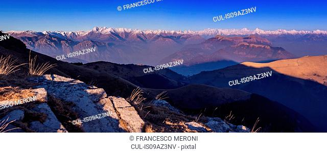 Elevated panoramic landscape with distant snow capped mountains, Monte Generoso,Ticino, Switzerland
