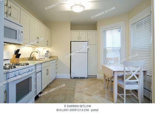 Light colored traditional kitchen