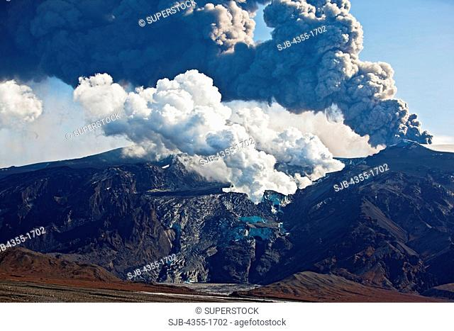 Steaming craters and an explosion at The Eyjafjallajokull volcanic eruption on Mt. Eyjafjoll in Iceland