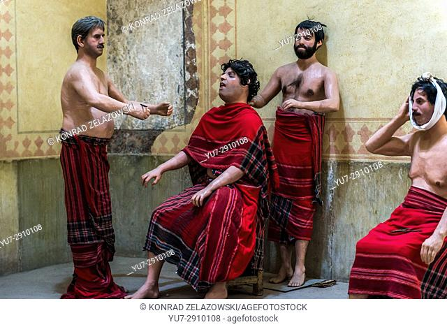 Wax figures dentist scene in old public baths called Vakil Bath in Shiraz city, capital of Fars Province in Iran