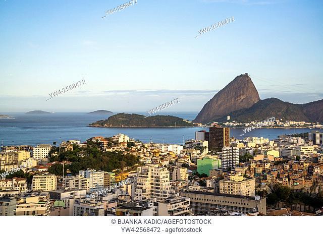 View of Rio city centre including the Sugar Loaf from Parque das Ruínas cultural centre, Santa Teresa neighbourhood, Rio de Janeiro, Brazil