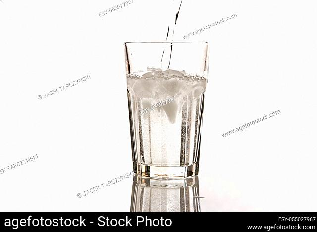 glass of mineral water with ice isolated on white