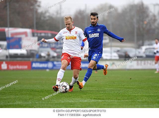 duels, duel between Alexander Nandzik (Jahn Regensburg) and Burak Camoglu (KSC). GES / Fussball / 3. Liga Test match: Karlsruher SC - Jahn Regensburg, 15