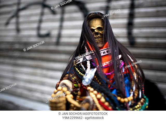 A figurine of Santa Muerte (Saint Death) seen during the pilgrimage in Tepito, a dangerous district of Mexico City, Mexico, 1 June 2011